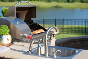 8727140-cooking-cedar-salmon-on-the-barbecue-at-the-outdoor-kitchen