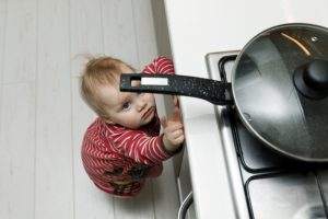 Child,Safety,At,Home,Concept,-,Toddler,Reaching,For,Pan